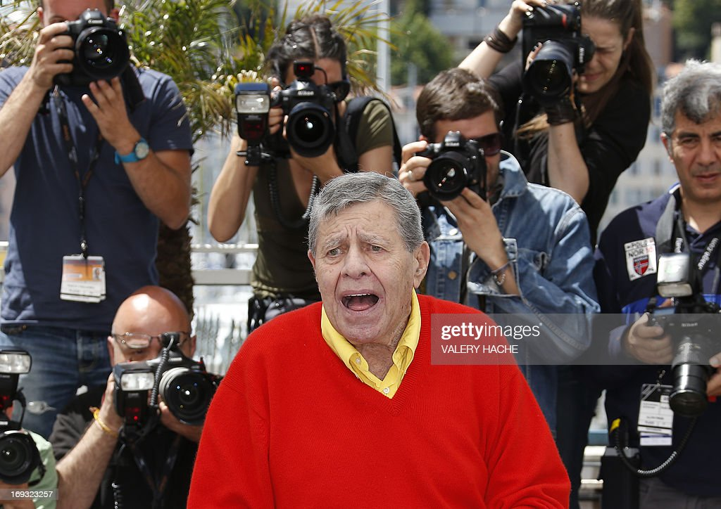 US comedian Jerry Lewis poses on May 23, 2013 during a photocall for the film 'Max Rose' presented Out of Competition at the 66th edition of the Cannes Film Festival in Cannes. Cannes, one of the world's top film festivals, opened on May 15 and will climax on May 26 with awards selected by a jury headed this year by Hollywood legend Steven Spielberg. AFP PHOTO / VALERY HACHE