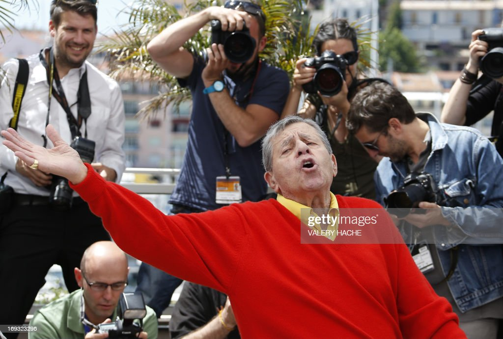 US comedian Jerry Lewis poses on May 23, 2013 during a photocall for the film 'Max Rose' presented Out of Competition at the 66th edition of the Cannes Film Festival in Cannes. Cannes, one of the world's top film festivals, opened on May 15 and will climax on May 26 with awards selected by a jury headed this year by Hollywood legend Steven Spielberg.