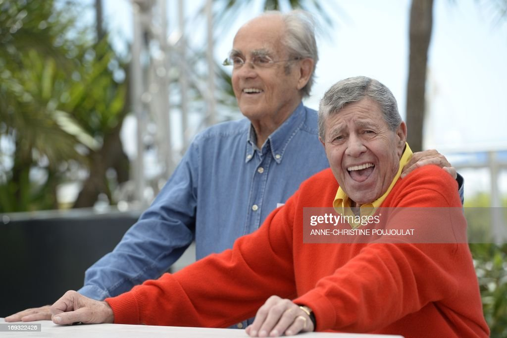 US comedian Jerry Lewis (R) poses on May 23, 2013 with French composer Michel Legrand during a photocall for the film 'Max Rose' presented Out of Competition at the 66th edition of the Cannes Film Festival in Cannes. Cannes, one of the world's top film festivals, opened on May 15 and will climax on May 26 with awards selected by a jury headed this year by Hollywood legend Steven Spielberg. AFP PHOTO / ANNE-CHRISTINE POUJOULAT