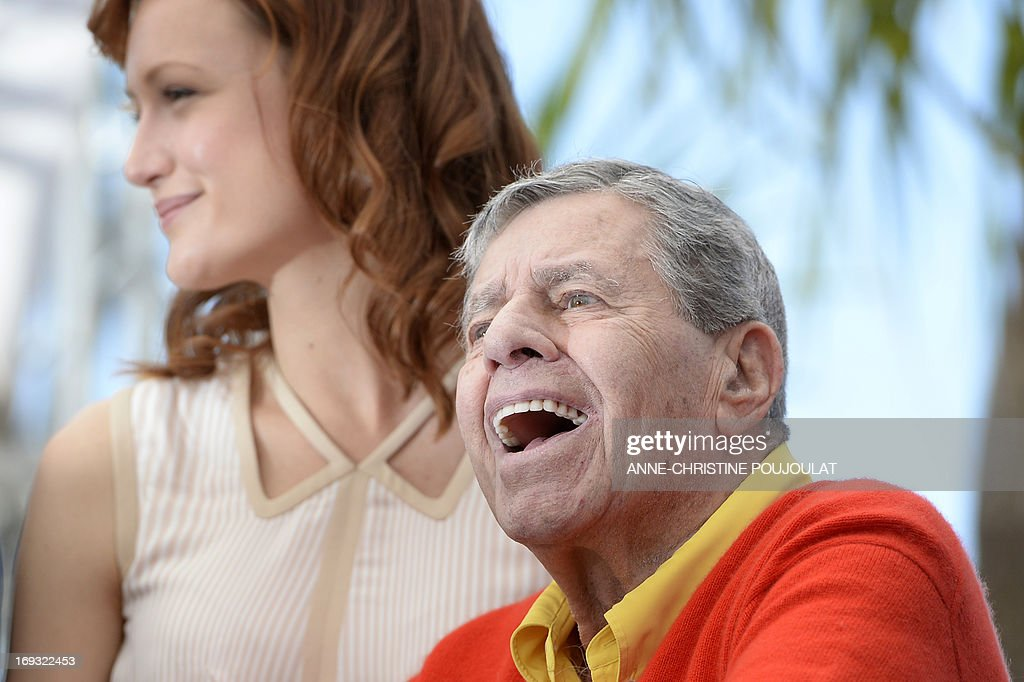 US comedian Jerry Lewis (R) poses on May 23, 2013 with US actress Kerry Bishe during a photocall for the film 'Max Rose' presented Out of Competition at the 66th edition of the Cannes Film Festival in Cannes. Cannes, one of the world's top film festivals, opened on May 15 and will climax on May 26 with awards selected by a jury headed this year by Hollywood legend Steven Spielberg.