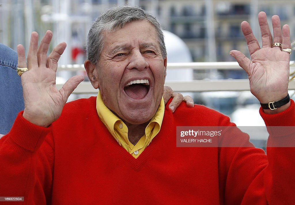US comedian Jerry Lewis raises his hands on May 23, 2013 while posing during a photocall for the film 'Max Rose' presented Out of Competition at the 66th edition of the Cannes Film Festival in Cannes. Cannes, one of the world's top film festivals, opened on May 15 and will climax on May 26 with awards selected by a jury headed this year by Hollywood legend Steven Spielberg.