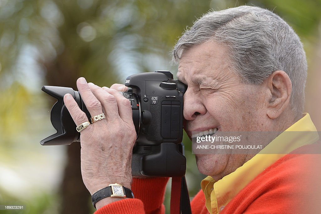 US comedian Jerry Lewis takes photos of the photographers on May 23, 2013 during a photocall for the film 'Max Rose' presented Out of Competition at the 66th edition of the Cannes Film Festival in Cannes. Cannes, one of the world's top film festivals, opened on May 15 and will climax on May 26 with awards selected by a jury headed this year by Hollywood legend Steven Spielberg.