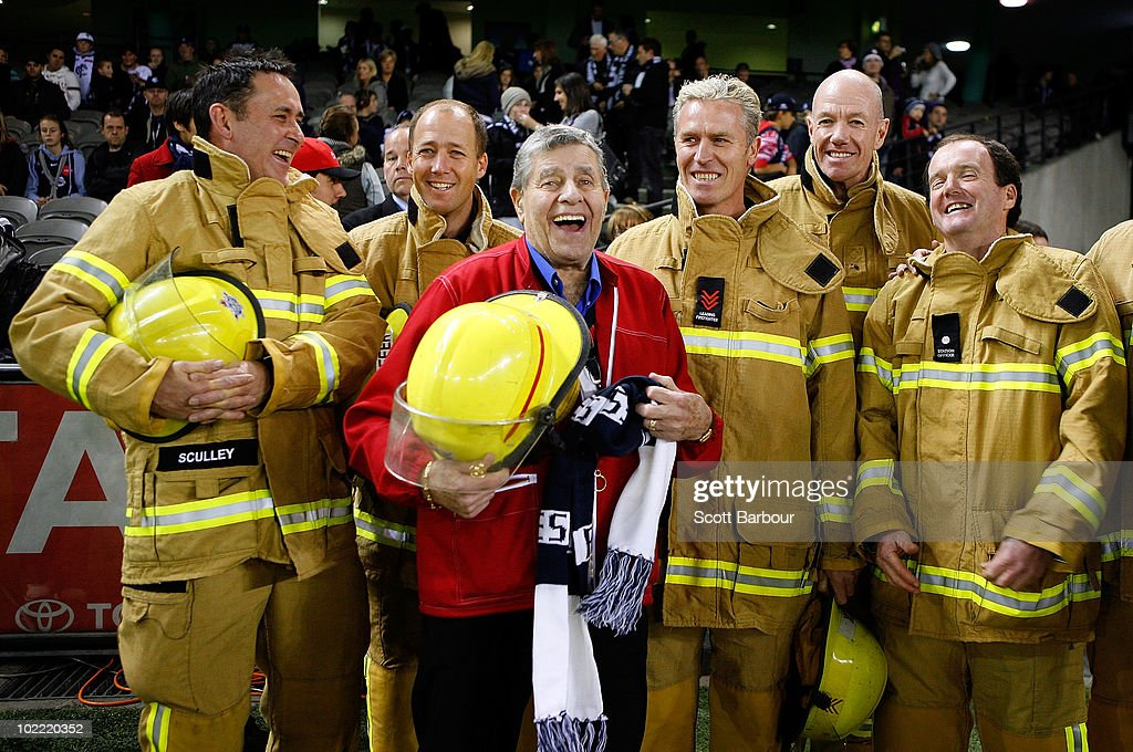 Comedian <a gi-track='captionPersonalityLinkClicked' href=/galleries/search?phrase=Jerry+Lewis+-+Comedian&family=editorial&specificpeople=202947 ng-click='$event.stopPropagation()'>Jerry Lewis</a> talks with a group of Australian firefighters before the round 13 AFL match between the Carlton Blues and the Fremantle Dockers at Etihad Stadium on June 19, 2010 in Melbourne, Australia.