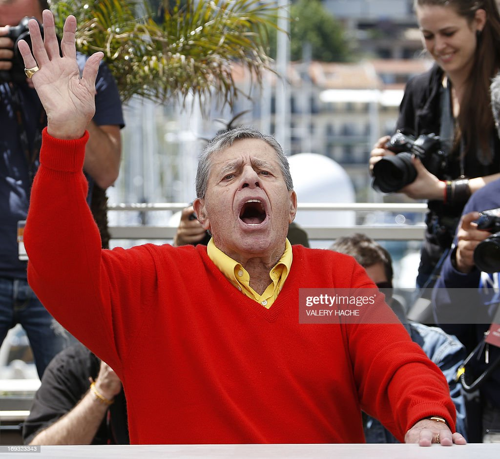 US comedian Jerry Lewis waves on May 23, 2013 while posing during a photocall for the film 'Max Rose' presented Out of Competition at the 66th edition of the Cannes Film Festival in Cannes. Cannes, one of the world's top film festivals, opened on May 15 and will climax on May 26 with awards selected by a jury headed this year by Hollywood legend Steven Spielberg.