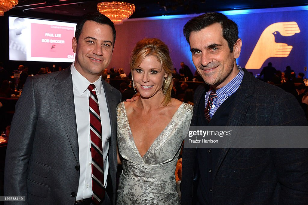 Comedian <a gi-track='captionPersonalityLinkClicked' href=/galleries/search?phrase=Jimmy+Kimmel&family=editorial&specificpeople=214115 ng-click='$event.stopPropagation()'>Jimmy Kimmel</a>l, actors Julia Bowen and <a gi-track='captionPersonalityLinkClicked' href=/galleries/search?phrase=Ty+Burrell&family=editorial&specificpeople=700077 ng-click='$event.stopPropagation()'>Ty Burrell</a> attend The Saban Free Clinic's Gala Honoring ABC Entertainment Group President Paul Lee And Bob Broder at The Beverly Hilton Hotel on November 19, 2012 in Beverly Hills, California.