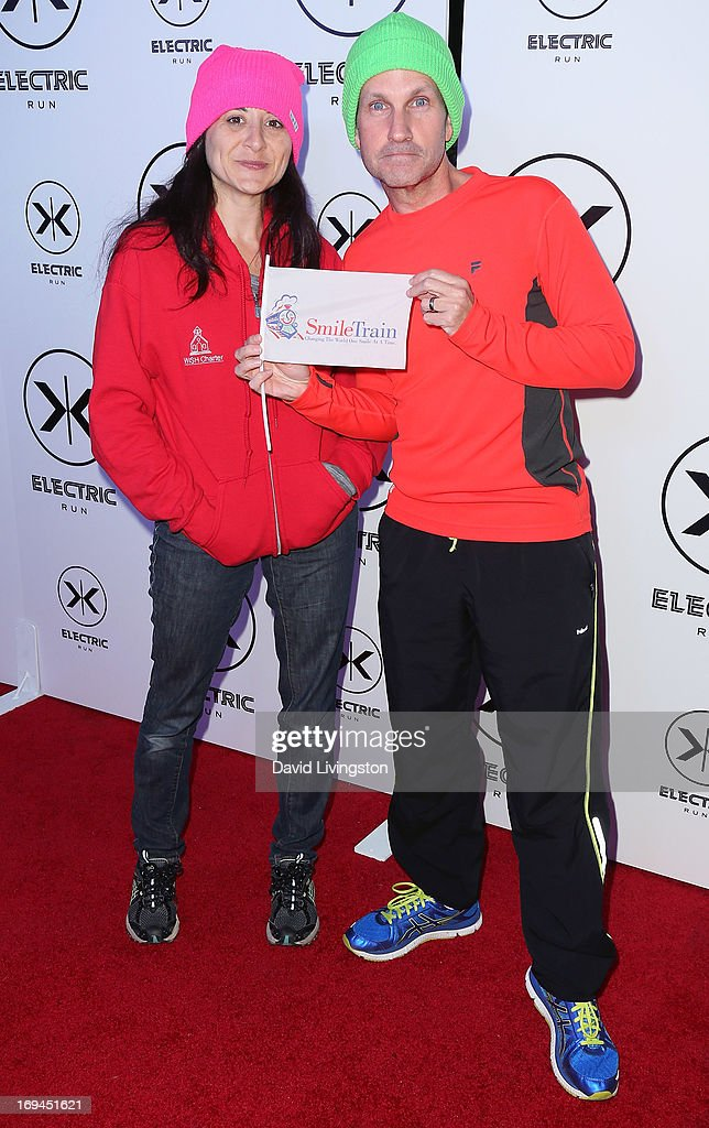 Comedian Jimmy Pardo (R) and wife Danielle Koenig attend Electric Run LA at The Home Depot Center on May 24, 2013 in Carson, California.
