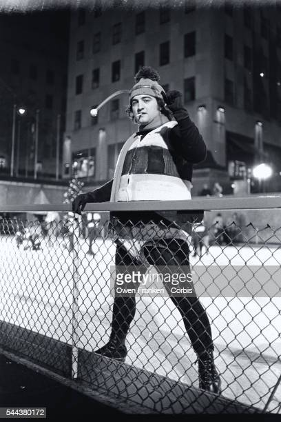 Comedian John Belushi in a bumble bee costume skates at the Rockefeller Center Ice Rink for a skit on Saturday Night Live
