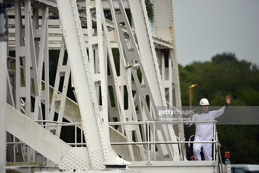 Comedian John Bishop carries the Olympic Torch to the dish of The Lovell Telescope at Jodrell Bank on May 31, 2012 in Holmes Chapel, England. The Olympic Torch visited The Lovell Radio Telescope which began operations in October of 1957 and was first used to track the carrier rocket that launched Sputnik I and later involved in the early exploration by U.S. and Russian space probes. The telescope was also the first to receive images from a Russian moon probe in 1959.The Olympic Flame is now on day 13 of a 70-day relay involving 8,000 torchbearers covering 8,000 miles.