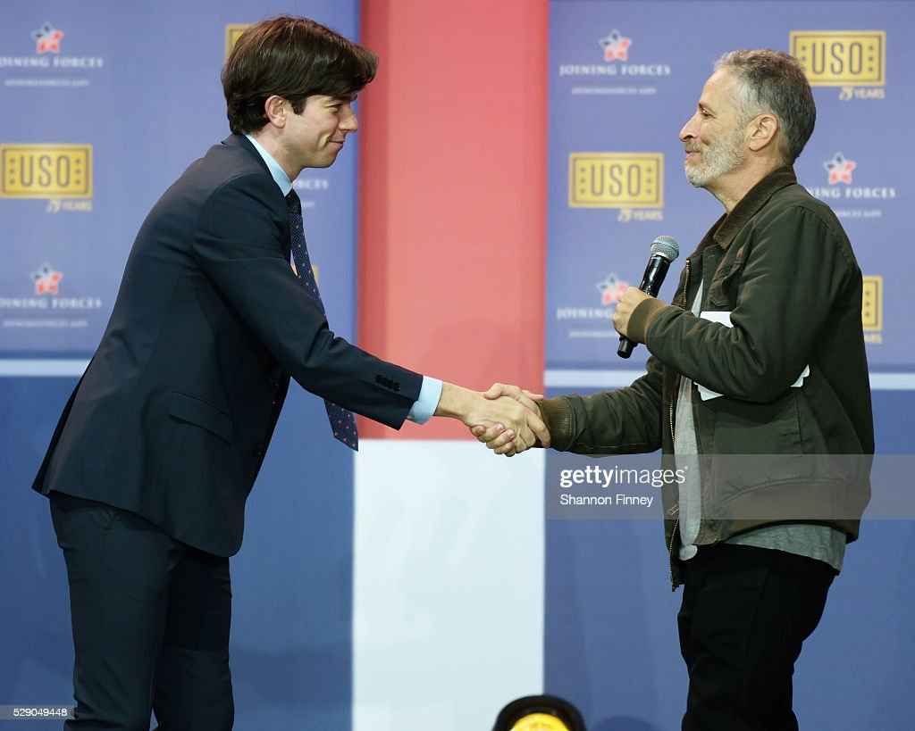 Comedian John Mulaney shakes hands with Master of Ceremonies Jon Stewart at the 75th Anniversary USO Show on May 5 2016 at Joint Base Andrews in Camp...
