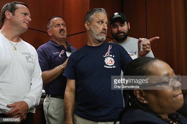 Comedian Jon Stewart joins ill firstresponders for a news conference to demand that Congress pass an extension of the Zadroga 9/11 health bill at the...