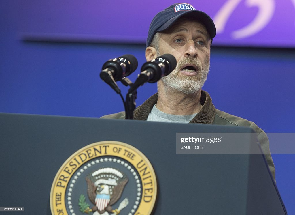 Comedian Jon Stewart speaks during a celebration of the 5th anniversary of Joining Forces and the 75th anniversary of the USO at Andrews Air Force Base in Maryland, May 5, 2016. / AFP / SAUL