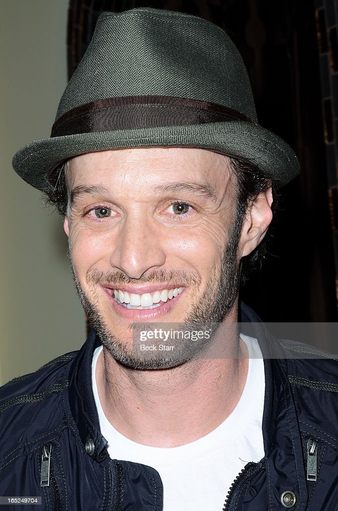 Comedian Josh Wolf signs copies of his new book 'It Takes Balls' at Skin Body Lounge on April 1, 2013 in Studio City, California.