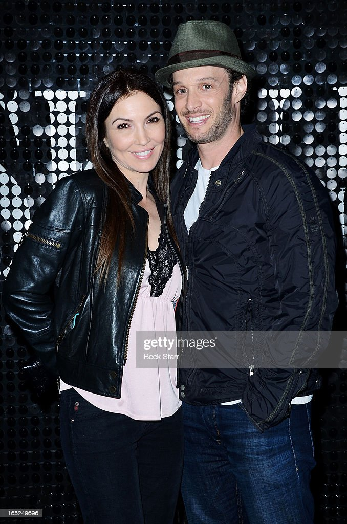 Comedian Josh Wolf with his girlfriend signs copies of his new book 'It Takes Balls' at Skin Body Lounge on April 1, 2013 in Studio City, California.