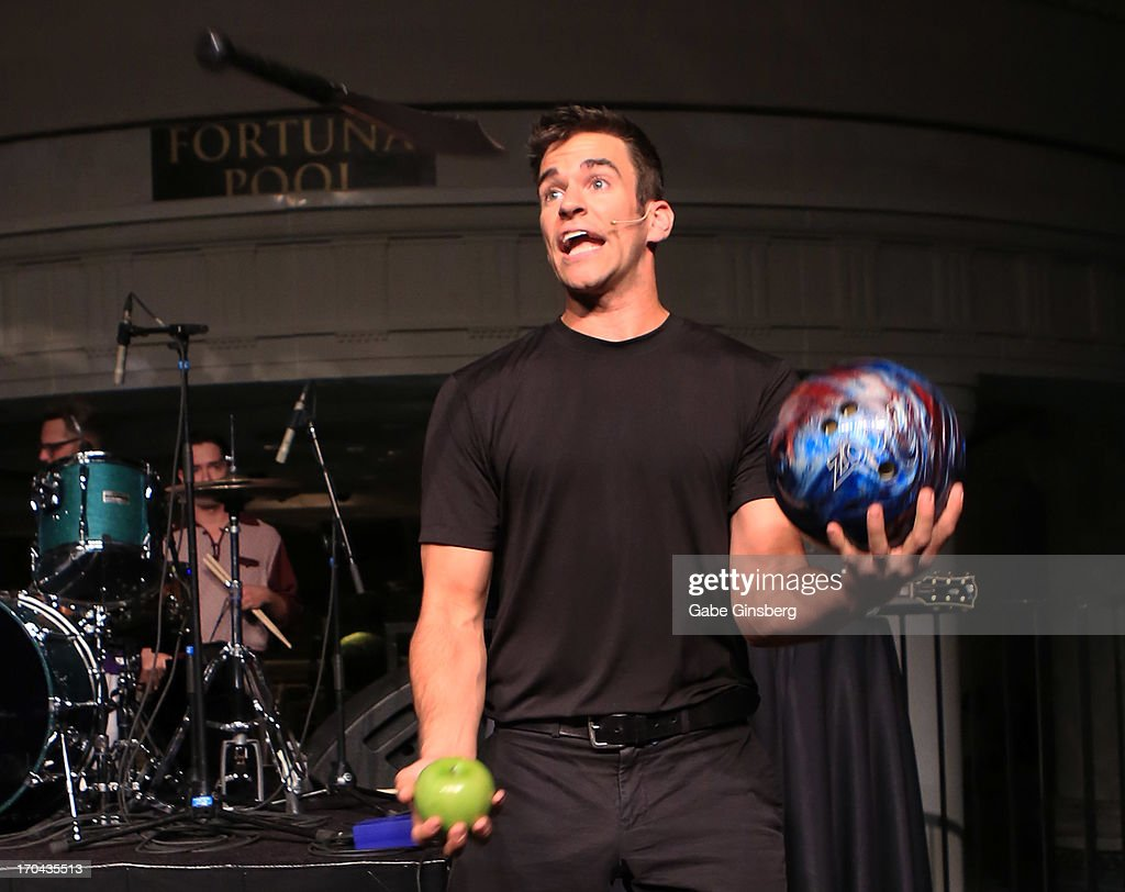 Comedian juggler Jeff Civillico performs at the closing night party for the U.S. Travel Association's International Pow Wow at the Garden of the Gods Pool at Caesars Palace on June 12, 2013 in Las Vegas, Nevada.