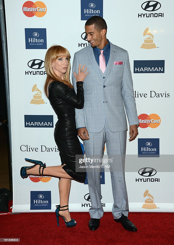 Comedian Kathy Griffin (L) and NFL player Colin Kaepernick arrive at Clive Davis & The Recording Academy's 2013 Pre-GRAMMY Gala and Salute to Industry Icons honoring Antonio 'L.A.' Reid at The Beverly Hilton Hotel on February 9, 2013 in Beverly Hills, California.