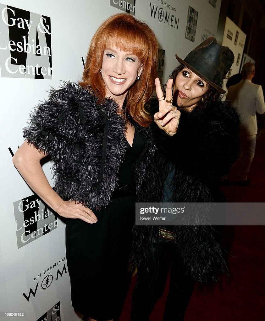 Comedian Kathy Griffin (L) and producer/musician Linda Perry arrive at An Evening With Women benefiting The L.A. Gay & Lesbian Center at the Beverly Hilton Hotel on May 18, 2013 in Beverly Hills, California.