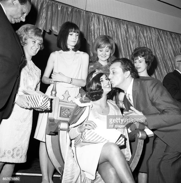 Comedian Ken Dodd claims a kiss as tribute from Miss Whitehall 1965 16yearold Lynette Mitchell after she had been crowned at the Army Department's...