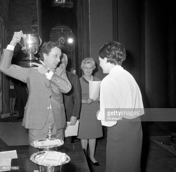Comedian Kenn Dodd shoulders the Hugh Myddelton Cup prior to presenting it to a delighted Linda Bullivant the sixteen year old deputy head girl of...