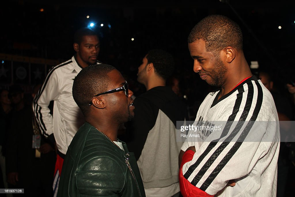 Comedian Kevin Hart and Chris Paul of the Western Conference All-Stars talk during the 2013 NBA All-Star Game during All Star Weekend on February 17, 2013 at the Toyota Center in Houston, Texas.