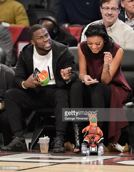 Comedian Kevin Hart and Eniko Parrish attend the 2016 NBA AllStar Saturday Night at Air Canada Centre on February 13 2016 in Toronto Canada