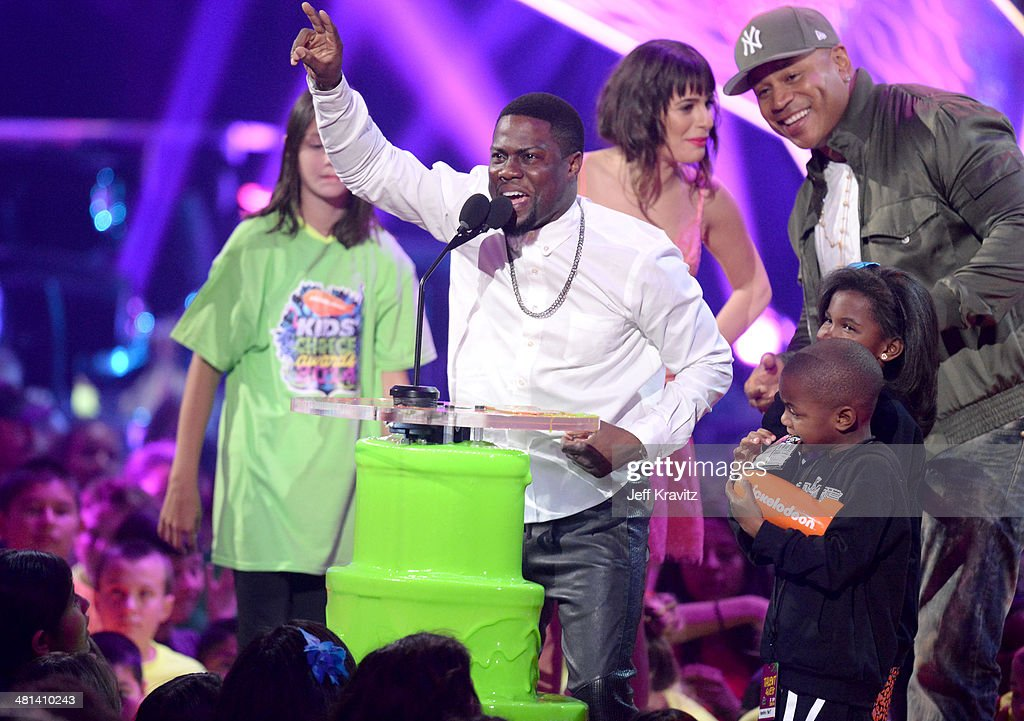 Comedian <a gi-track='captionPersonalityLinkClicked' href=/galleries/search?phrase=Kevin+Hart+-+Actor&family=editorial&specificpeople=4538838 ng-click='$event.stopPropagation()'>Kevin Hart</a> and Rapper/actor <a gi-track='captionPersonalityLinkClicked' href=/galleries/search?phrase=LL+Cool+J&family=editorial&specificpeople=201567 ng-click='$event.stopPropagation()'>LL Cool J</a> onstage at Nickelodeon's 27th Annual Kids' Choice Awards at USC Galen Center on March 29, 2014 in Los Angeles, California.