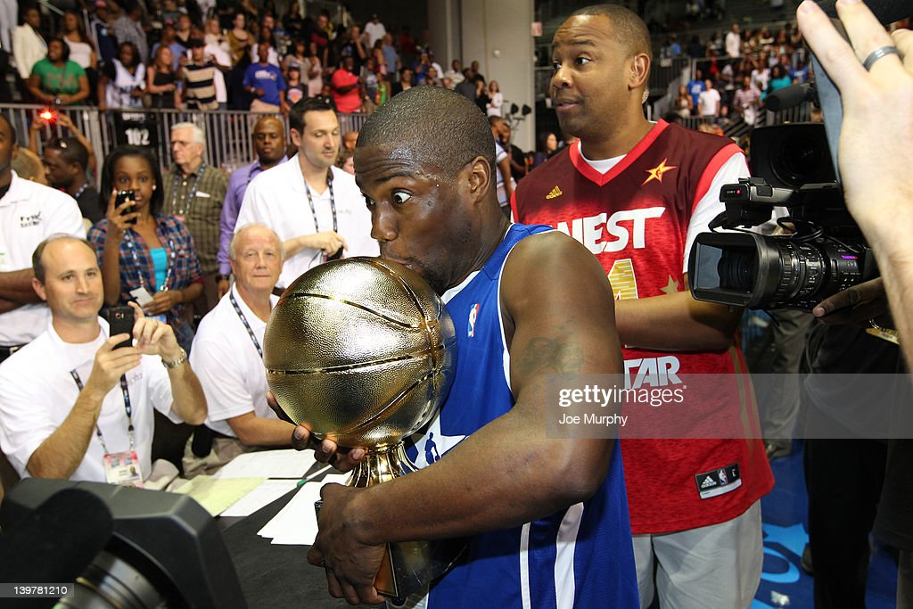 Comedian Kevin Hart of the East team celebrates his MVP award during the Sprint All-Star Celebrity Game on center court at Jam Session during the NBA All-Star Weekend on February 24, 2012 at the Orange County Convention Center in Orlando, Florida.