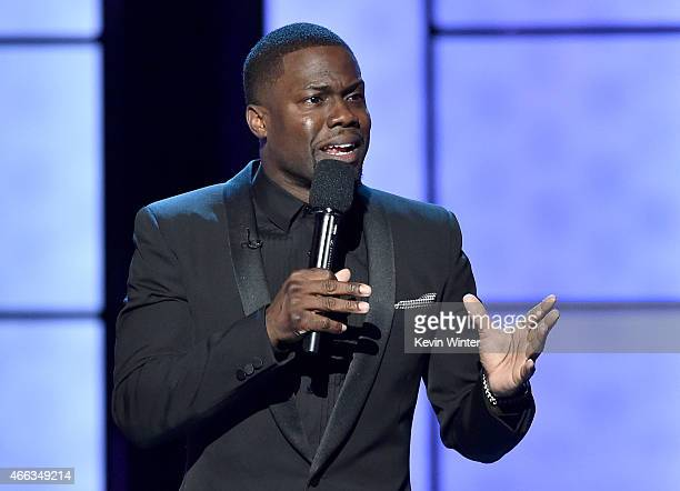 Comedian Kevin Hart speaks onstage at The Comedy Central Roast of Justin Bieber at Sony Pictures Studios on March 14 2015 in Los Angeles California...