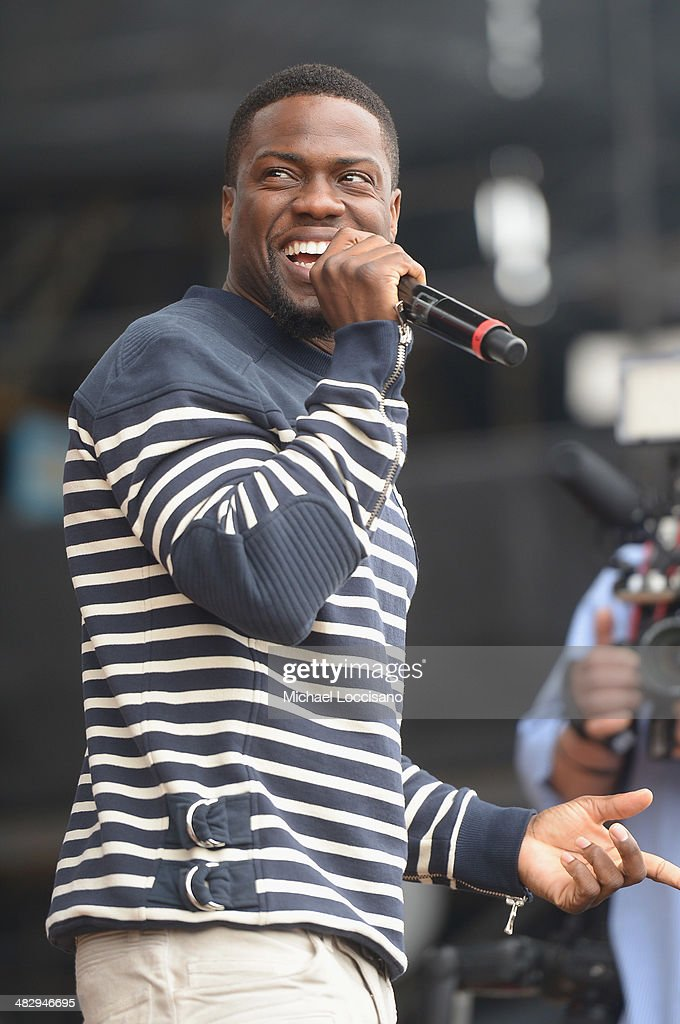 Comedian Kevin Hart speaks onstage during the Coke Zero Countdown at NCAA March Madness Music Festival Day 2 at Reunion Park on April 5 2014 in...