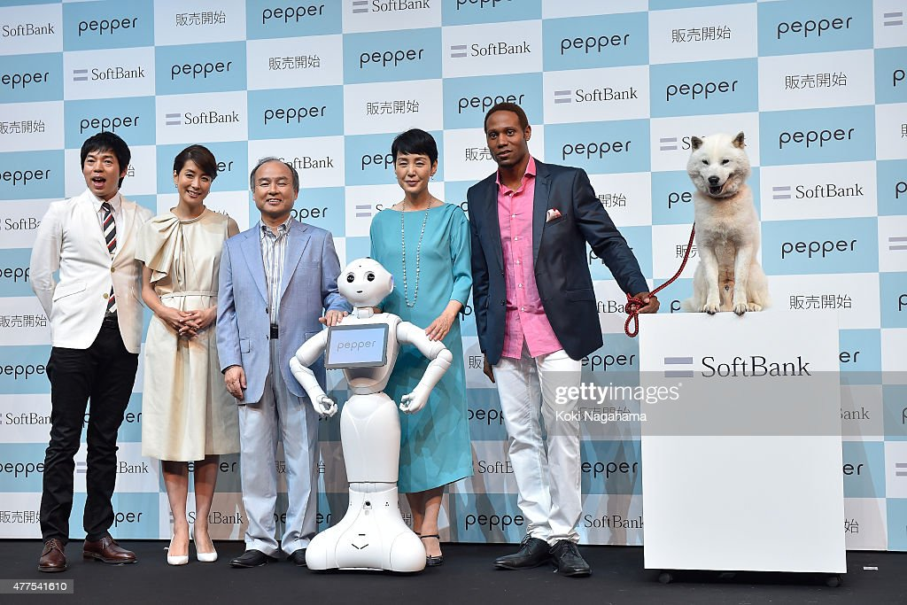 Comedian Koji Imada and Anouncer Kyoko Uchida and Chairman and chief executive officer of SoftBank Corp <a gi-track='captionPersonalityLinkClicked' href=/galleries/search?phrase=Masayoshi+Son&family=editorial&specificpeople=632759 ng-click='$event.stopPropagation()'>Masayoshi Son</a> and Actress <a gi-track='captionPersonalityLinkClicked' href=/galleries/search?phrase=Kanako+Higuchi&family=editorial&specificpeople=5367984 ng-click='$event.stopPropagation()'>Kanako Higuchi</a> and Actor <a gi-track='captionPersonalityLinkClicked' href=/galleries/search?phrase=Dante+Carver&family=editorial&specificpeople=5861053 ng-click='$event.stopPropagation()'>Dante Carver</a> pose for photograph with Pepper during the news conference on June 18, 2015 in Chiba, Japan. Softbank Corp. announced that its humanoid product, Pepper, developed by the company's Aldebaran Robotics unit, will be available for consumers at 198,000 yen on June 20, 2015. SoftBank Corp. also announced that Alibaba Group Holding Limited and Foxconn Technology Group reached an agreement that Alibaba and Foxconn will each invest 14.5 billion in SoftBank Robotics Holdings Corp., to promote Softbank's robotic business including Pepper to the global market.