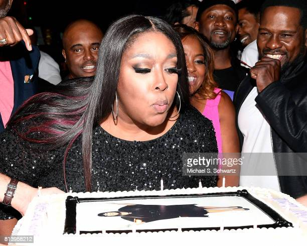 Comedian Loni Love blows out the candles on her cake at the after party at Loni Love's Birthday Roast benefiting the Dress For Success charity at...