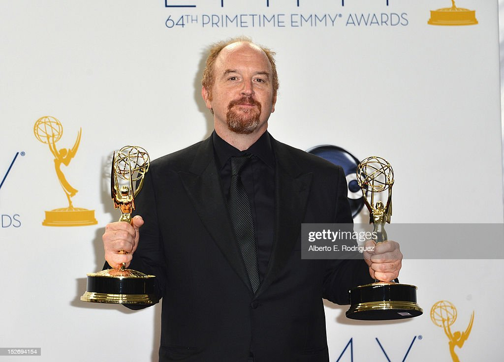 Comedian Louie C.K. poses in the 64th Annual Emmy Awards press room at Nokia Theatre L.A. Live on September 23, 2012 in Los Angeles, California.