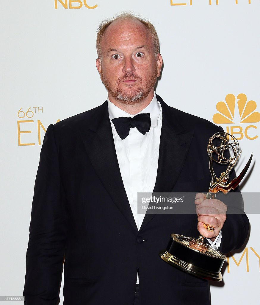 Comedian Louis C.K. poses in the press room at the 66th Annual Primetime Emmy Awards at the Nokia Theatre L.A. Live on August 25, 2014 in Los Angeles, California.
