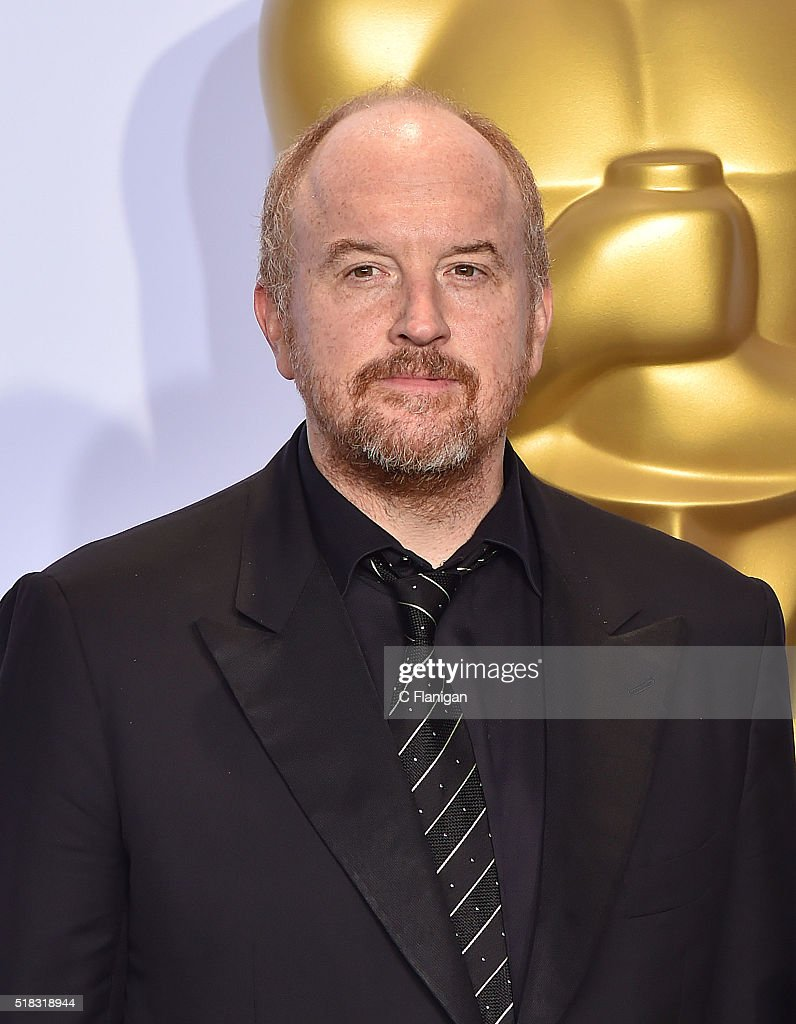 Comedian Louis C.K. poses in the press room during the 88th Annual Academy Awards at Loews Hollywood Hotel on February 28, 2016 in Hollywood, California.