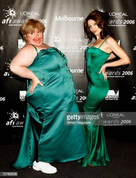 Comedian Magda Szubanski and singer Dannii Minogue pose in the Awards Room having presented an award to Heath Ledger backstage at the L'Oreal Paris...