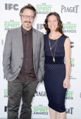 Comedian Marc Maron and Moon Zappa attend the 2014 Film Independent Spirit Awards at Santa Monica Beach on March 1 2014 in Santa Monica California