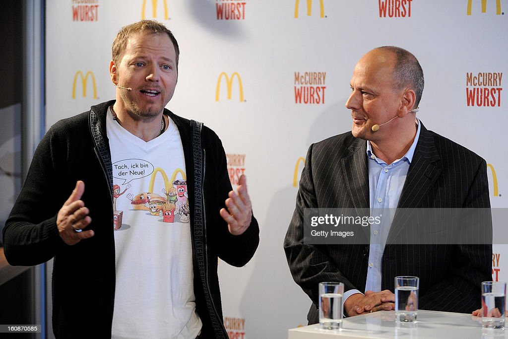 Comedian <a gi-track='captionPersonalityLinkClicked' href=/galleries/search?phrase=Mario+Barth&family=editorial&specificpeople=587497 ng-click='$event.stopPropagation()'>Mario Barth</a> and Managing Director McDonald's Germany Holger Beeck (l-r) pose during the presentation of McCurrywurst from McDonald's on February 7, 2013 in Dortmund, Germany.