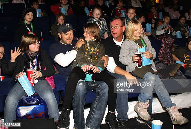 Comedian Mario Barth and reverend Bernd Siggelkow attend the 'Mario Barth Invites 200 Arche Kids To The Cinema 2011' event on December 9 2011 in...