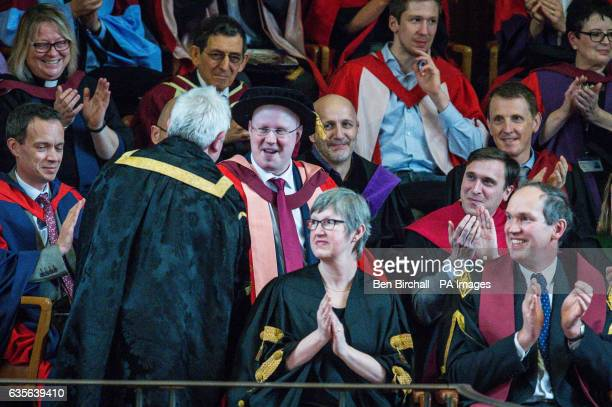 Comedian Matt Lucas shakes hands with Chancellor of Bristol University Sir Paul Nurse after receiving his Honorary Doctorate degree from the...