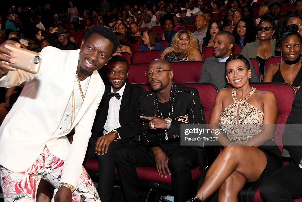 Comedian Michael Blackson, boxer Floyd Mayweather and Melissia Brim take a selfie during the 2016 BET Awards at the Microsoft Theater on June 26, 2016 in Los Angeles, California.