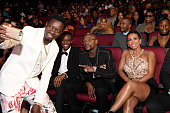 Comedian Michael Blackson boxer Floyd Mayweather and Melissia Brim take a selfie during the 2016 BET Awards at the Microsoft Theater on June 26 2016...