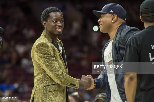 Comedian Michael Blackson is greeted by rapper LL Cool J during a BIG3 Basketball league game on July 16 2017 at Wells Fargo Center in Philadelphia PA