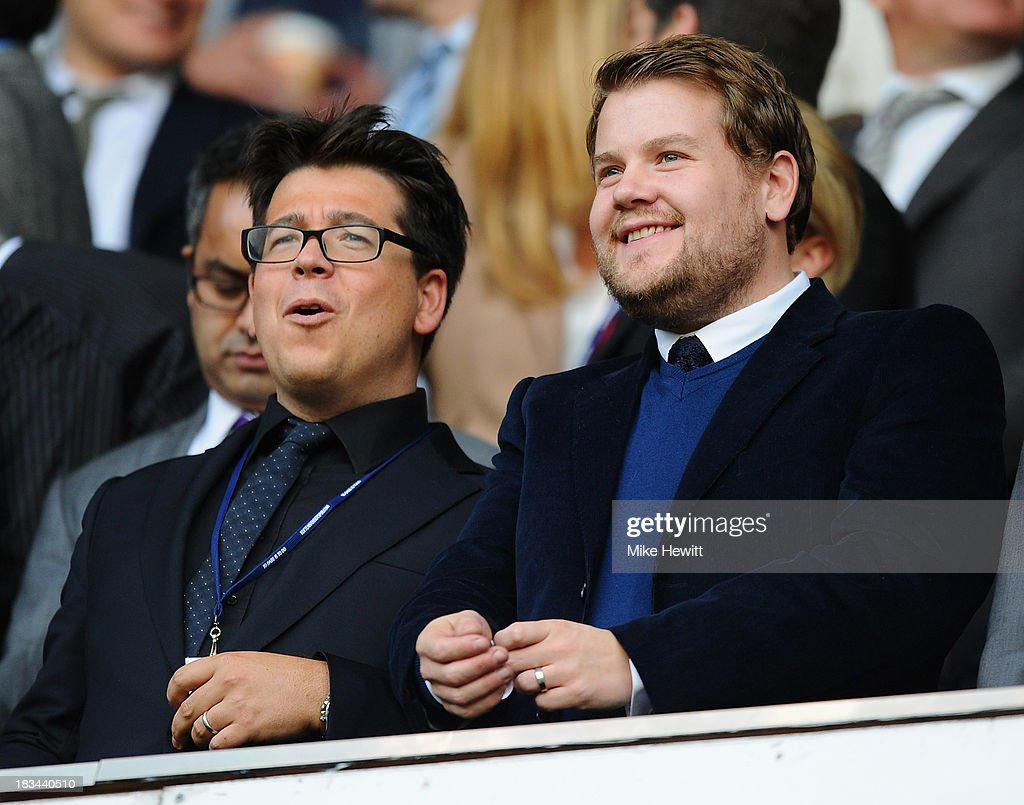 Comedian Michael McIntyre (L) and actor James Corden enjoy the action during the Barclays Premier League match between Tottenham Hotspur and West Ham United at White Hart Lane on October 6, 2013 in London, England.