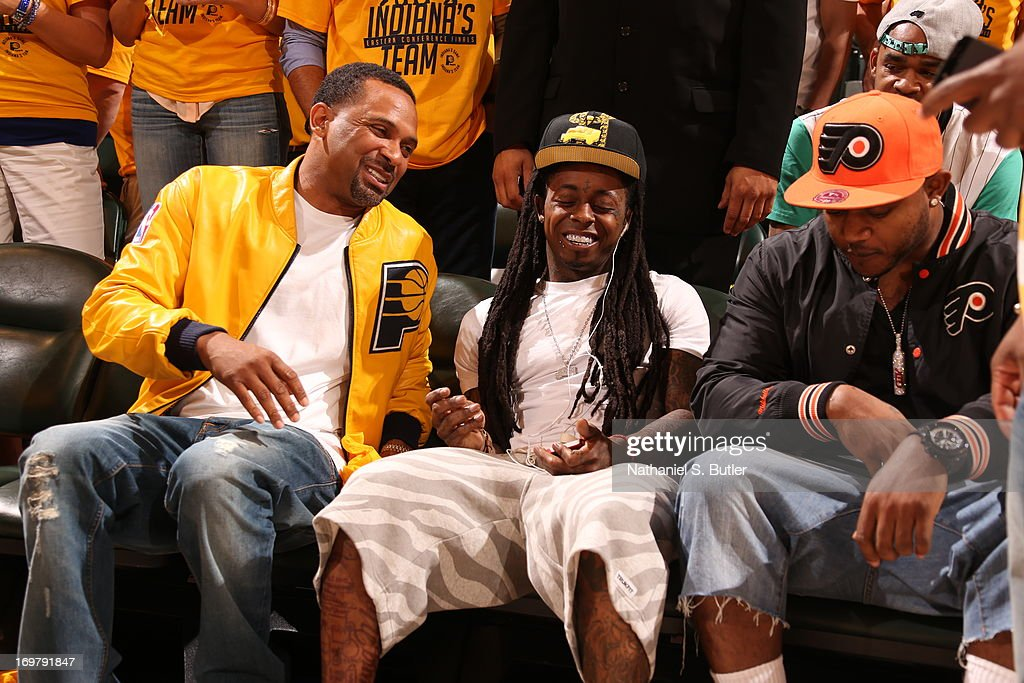 Comedian Mike Epps and Recording Artist Lil Wayne seated court side in Game Six of the Eastern Conference Finals between the Miami Heat and the Indiana Pacers during the 2013 NBA Playoffs on June 1, 2013 at Bankers Life Fieldhouse in Indianapolis, Indiana.