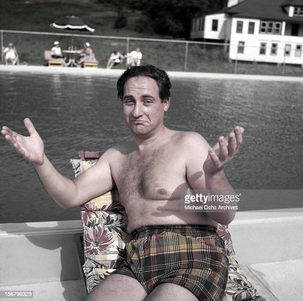 Comedian musician and television pioneer Sid Caesar poses for a portrait by a pool circa 1960