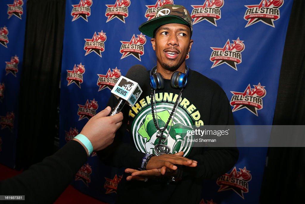 Comedian Nick Cannon speaks with a reporter on the All-Star Red Carpet prior to the 2013 NBA All-Star Game presented by Kia Motors on February 17, 2013 at the Toyota Center in Houston, Texas.