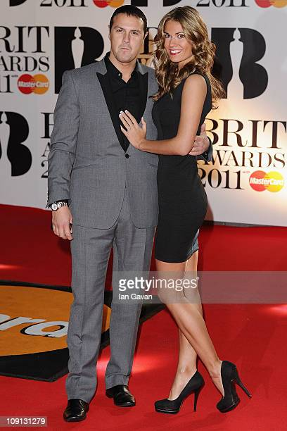 Comedian Paddy McGuinness and Christine Martin arrive on the red carpet for The BRIT Awards 2011 at the O2 Arena on February 15 2011 in London England