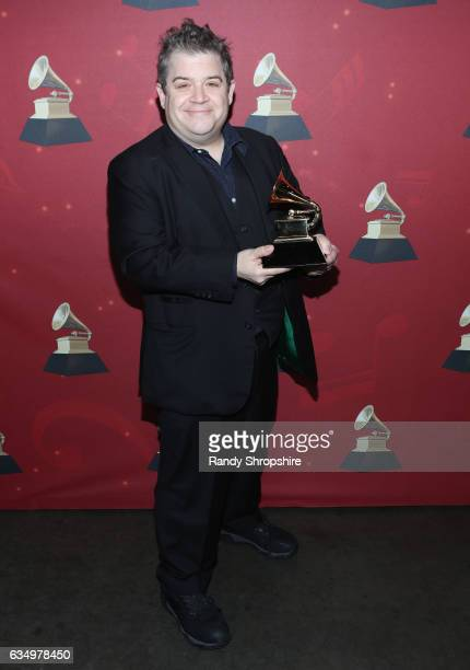 Comedian Patton Oswalt poses with the Best Comedy Album award for 'Talking for Clapping' backstage at the Premiere Ceremony during the 59th GRAMMY...