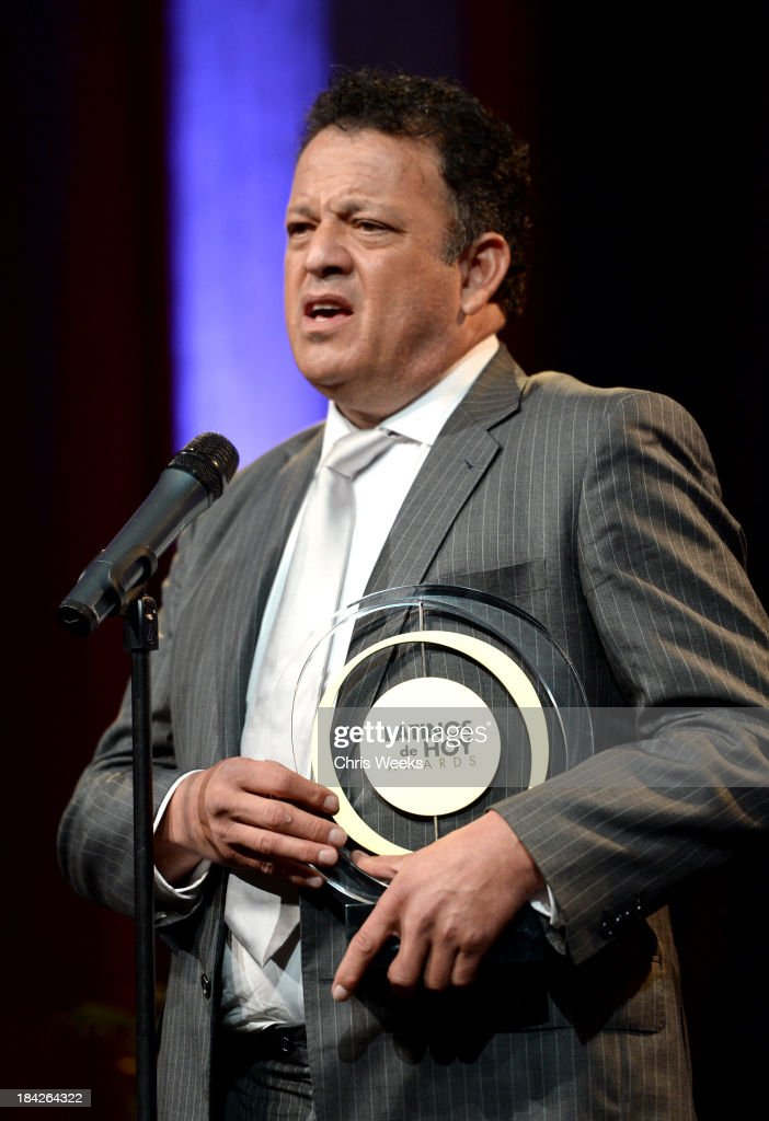Comedian Paul Rodriguez accepts the award for 2013 Community Advocate Award onstage at Latinos de Hoy Awards' Sponsored by OneLegacy on Saturday, October 12 at Los Angeles Times Chandler Auditorium in Los Angeles, California.