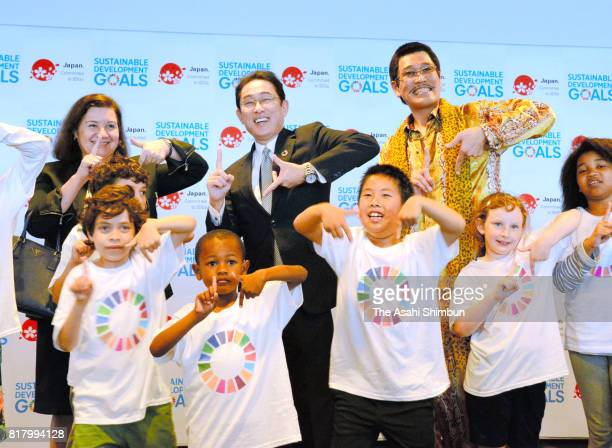Comedian Pikotaro holds his pose of g17h showing 17 goals which SDGs aim for with Foreign Minister Fumio Kishida and kids at the UN headquarters on...