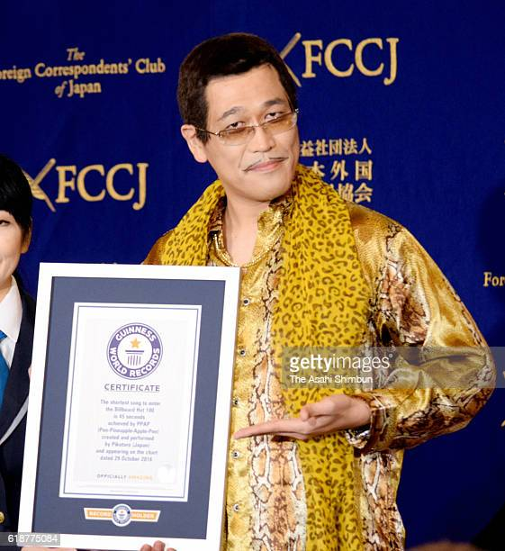 Comedian PIKOTARO pose for photographs with the Guinness World Certificate as his song 'PenPineappleApplePen ' is recongised as the shortest song to...